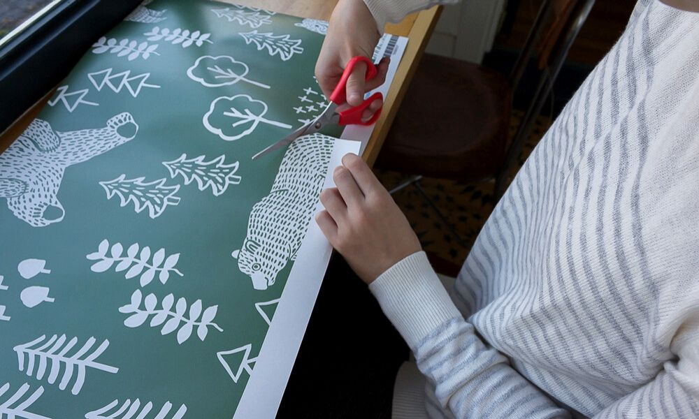 Cut out design elements from a wallpaper swatch to practice for fine motor skills for seniors and kids.   Spoonflower Blog