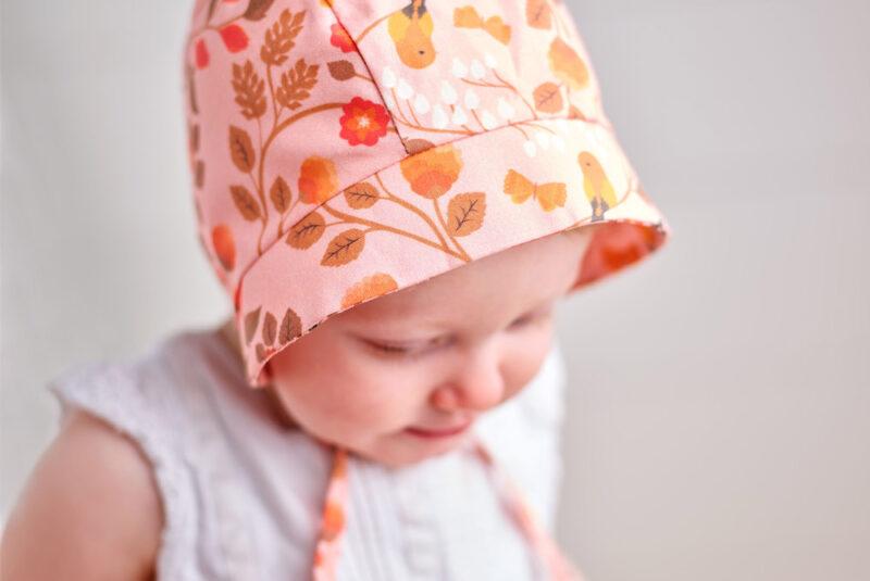 Baby wearing a handmade baby bonnet