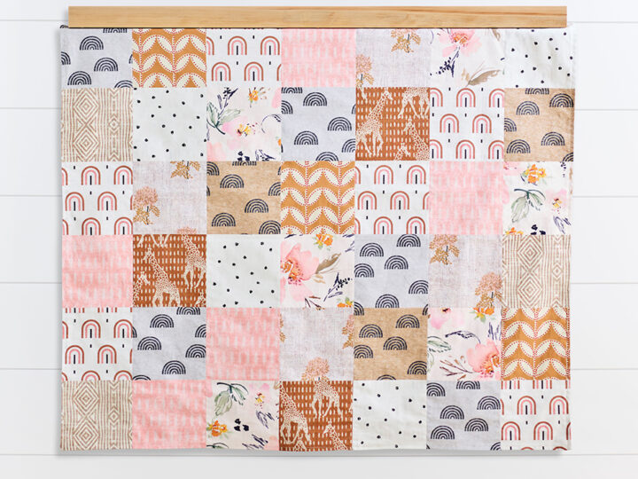 Peach and rust colored quilt made from Spoonflower's Fill-A-Yard