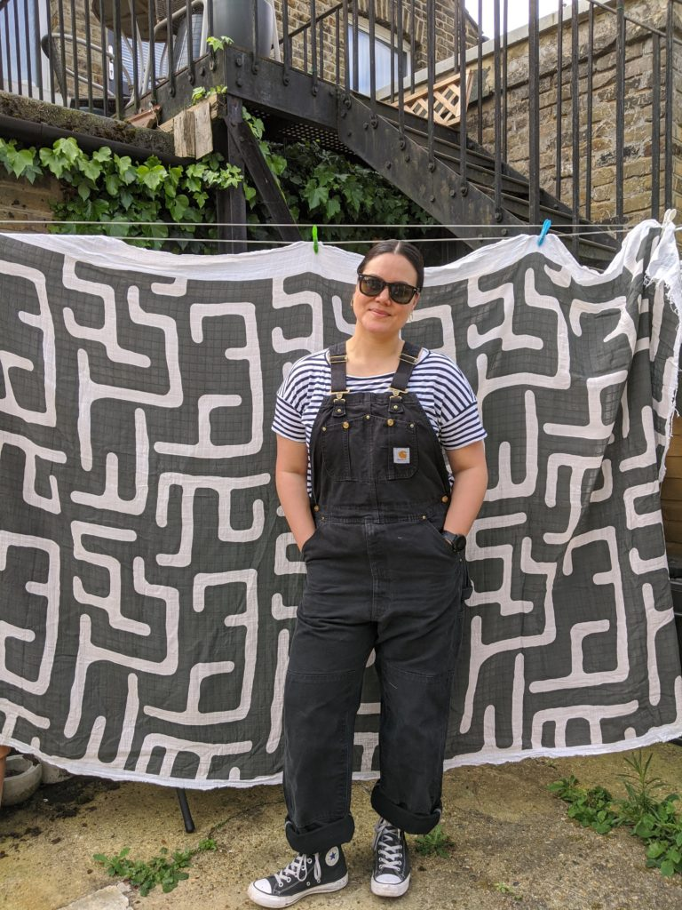 Tara stands in front of her washed Organic Sweet Pea Gauze | Spoonflower Blog
