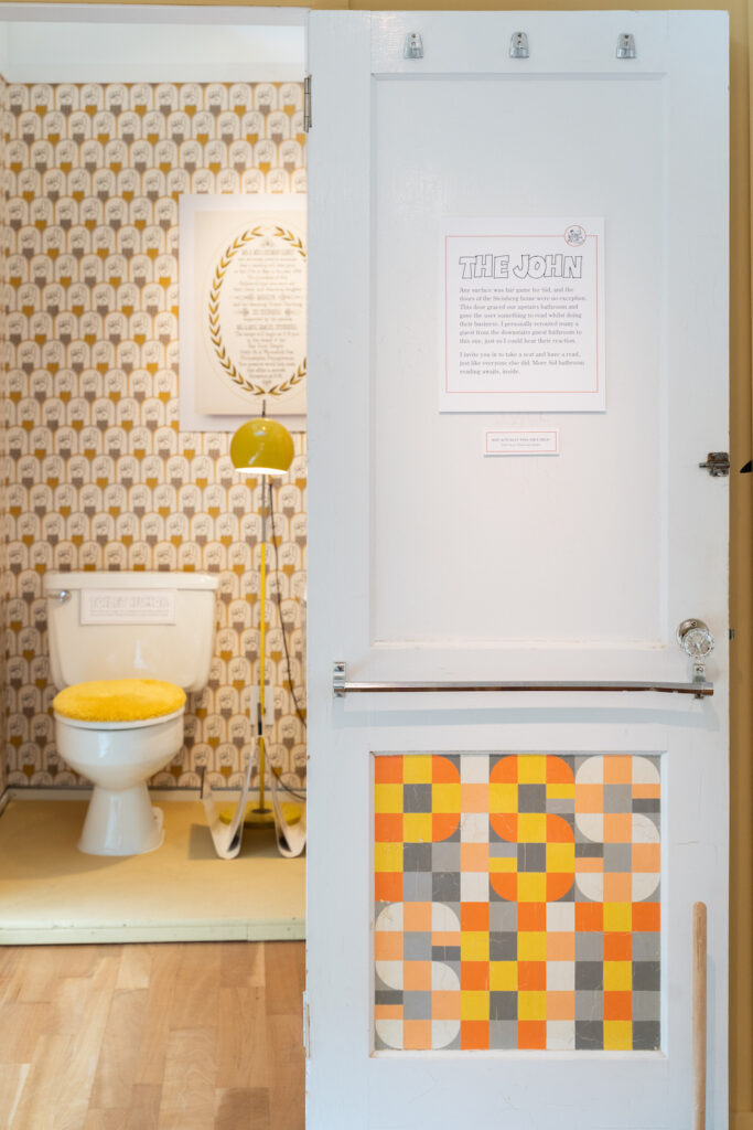 Bathroom featuring Spoonflower wallpaper and the original door from Ellen's childhood | Spoonflower Blog