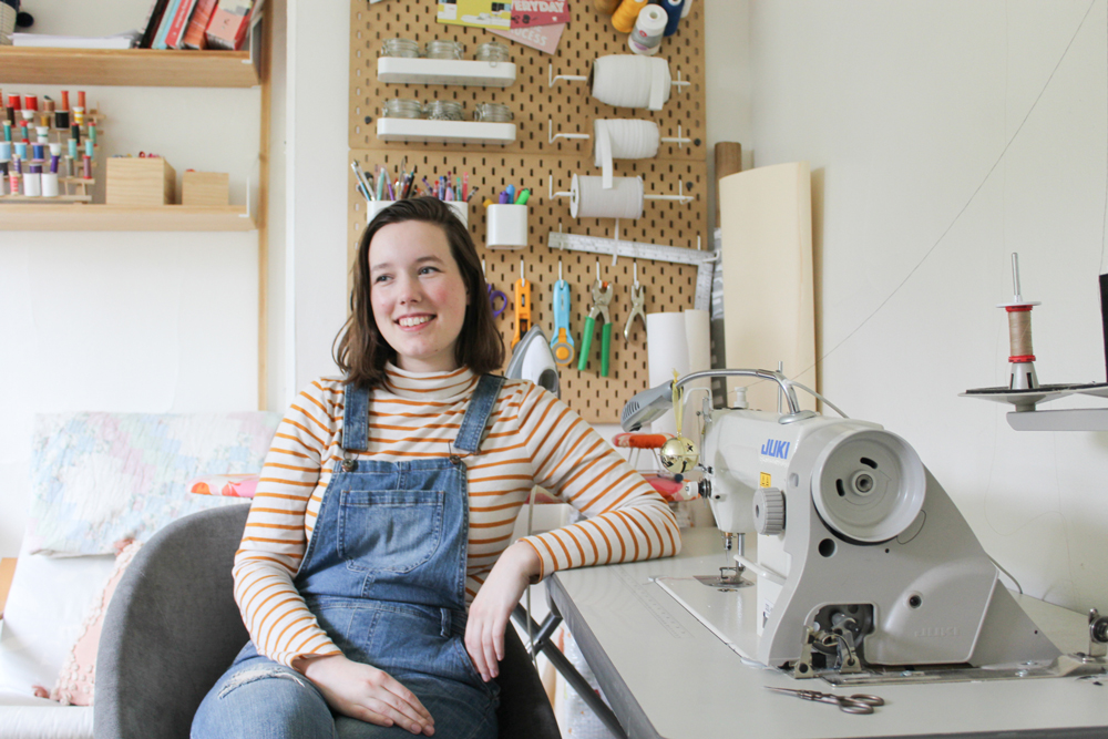 Monica Bacon sitting at her sewing desk