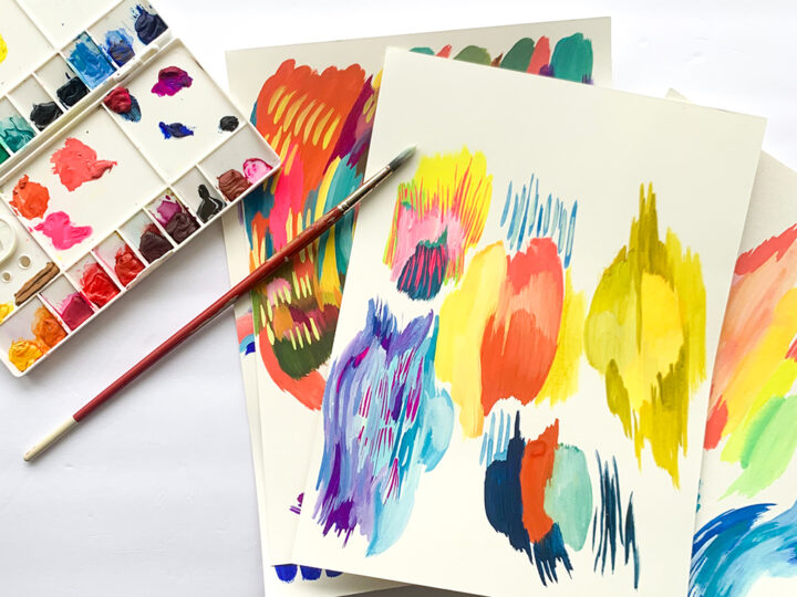 Paint palette with colorful paintings with bold brushstrokes