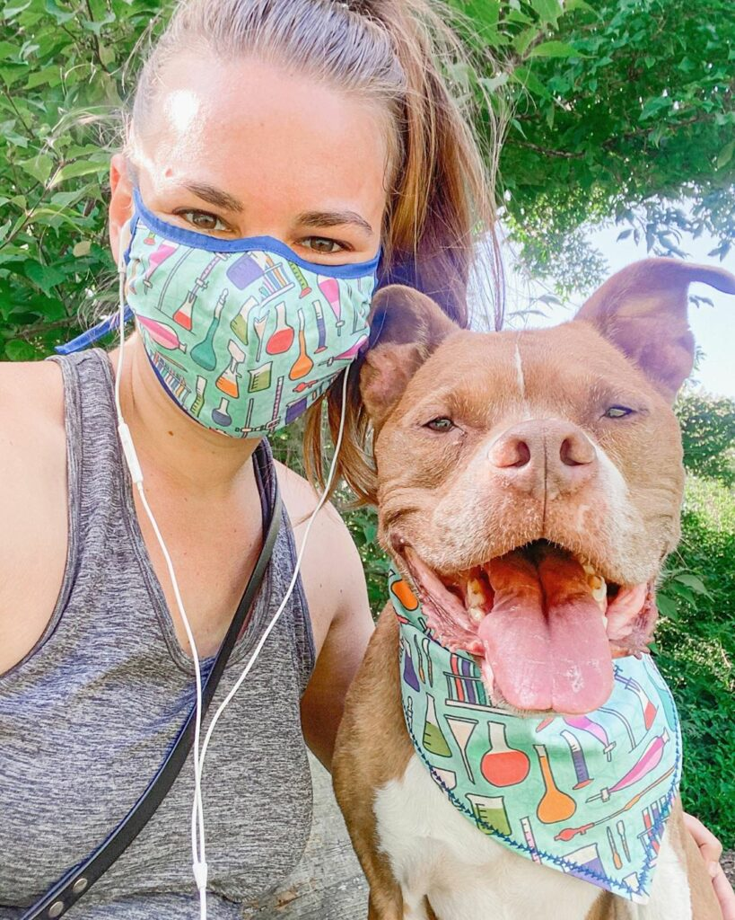 A mom and her pup wear a mask and bandana featuring a beaker design | Spoonflower Blog