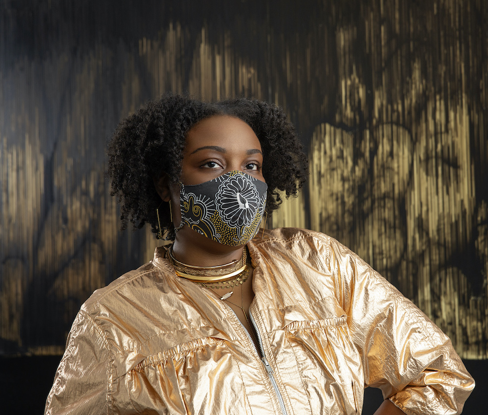 Artist and small business owner Tiffany McKnight models one of her handmade masks she designs