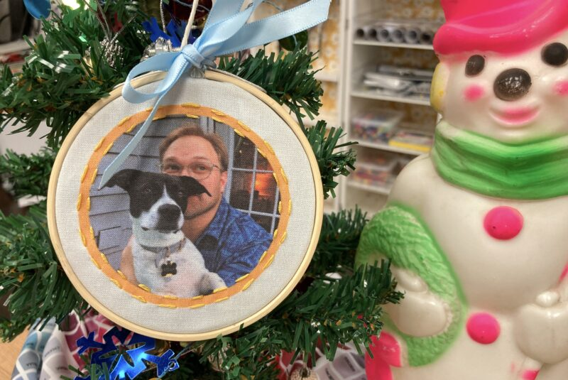 A handmade fabric ornament with digitally printed photos