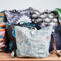 A variety of backpacks made with different colorful fabrics.
