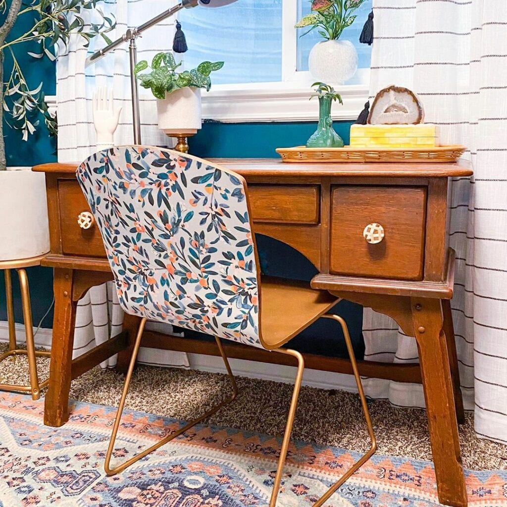 A desk chair features a wallpaper with a fruit and leaves design