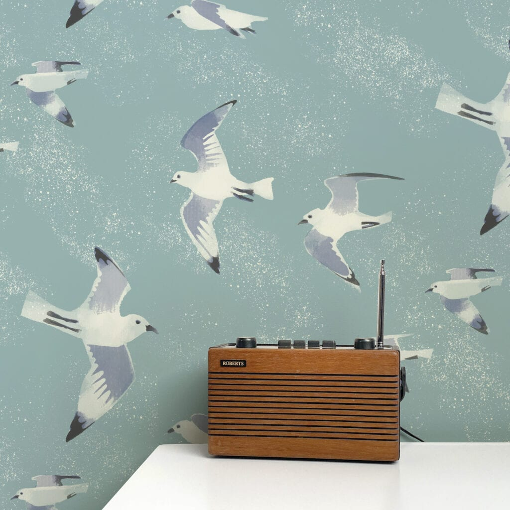Wallpaper featuring a seagull design with a table and vintage radio