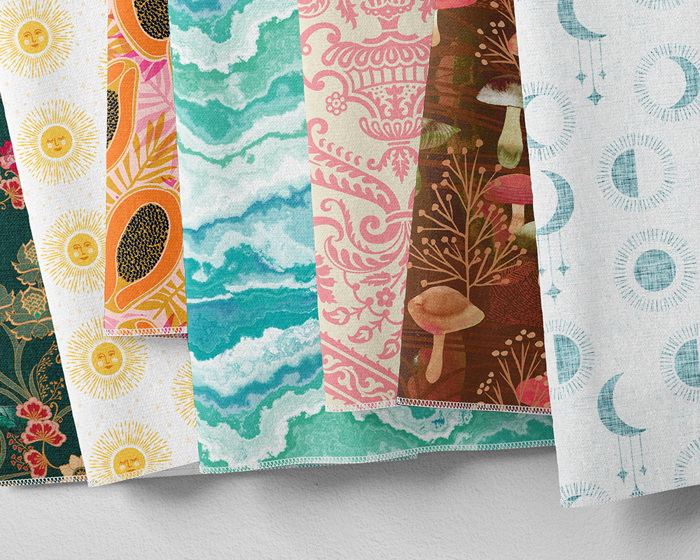 Seven swatches of fabric featuring papayas, moons, mushrooms and damask designs