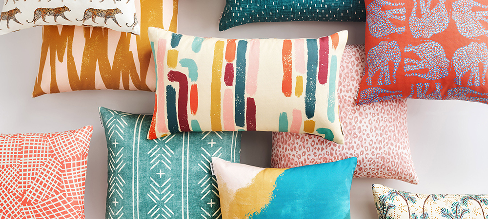 A collection of throw pillows featuring bright and colorful designs
