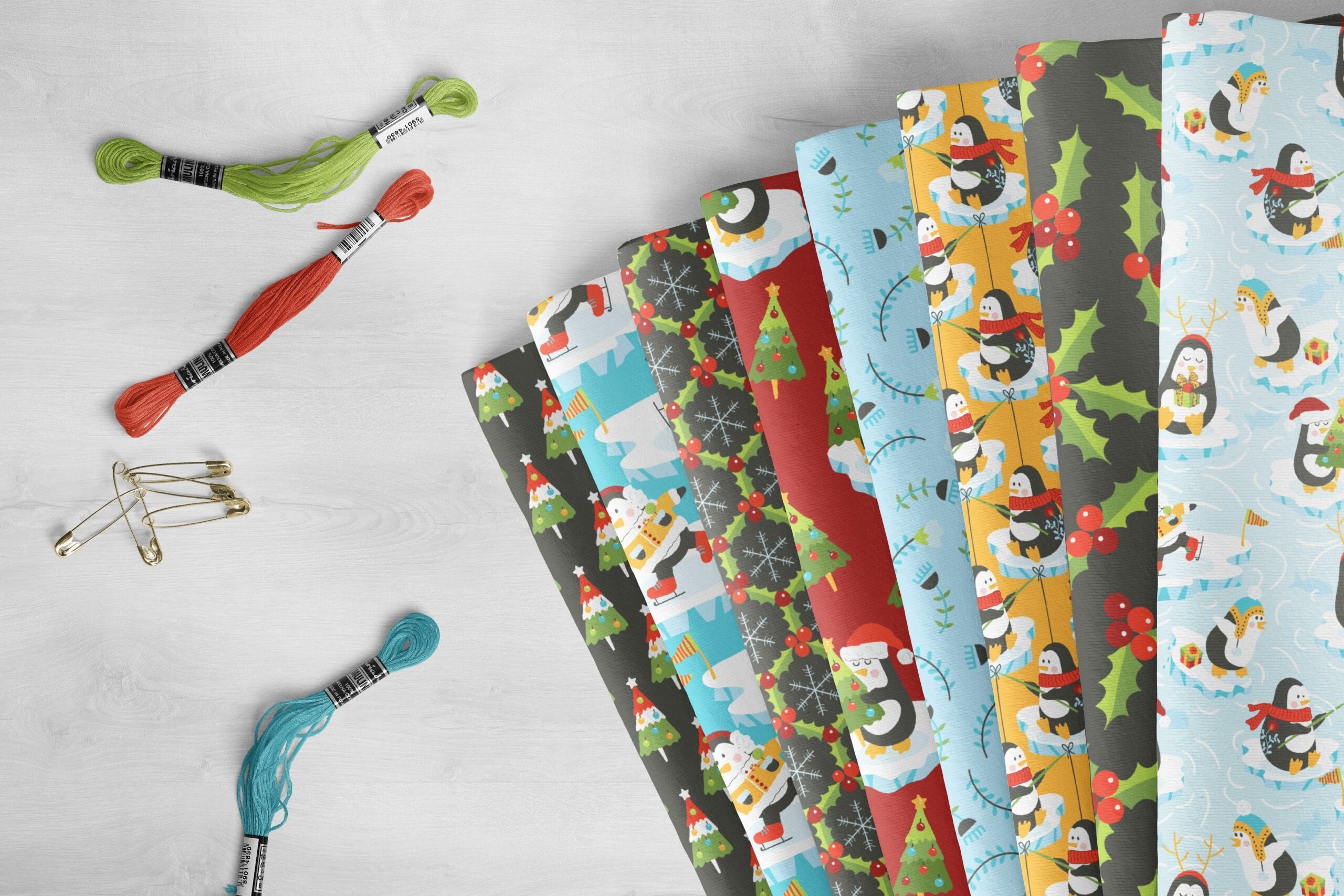 Holiday fabrics featuring penguin, holly, and evergreen tree designs
