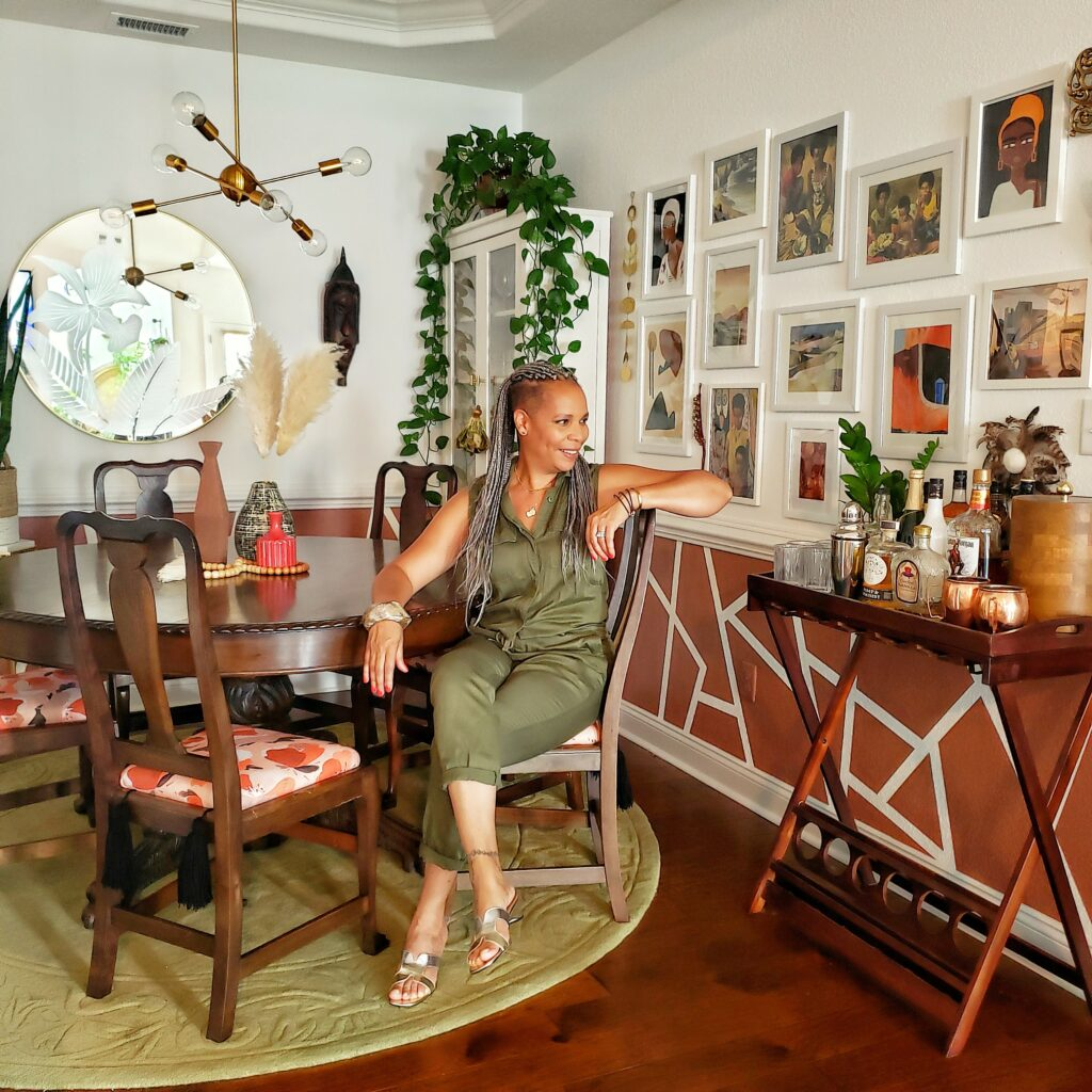 Tracey Hairston sits at her dining room table