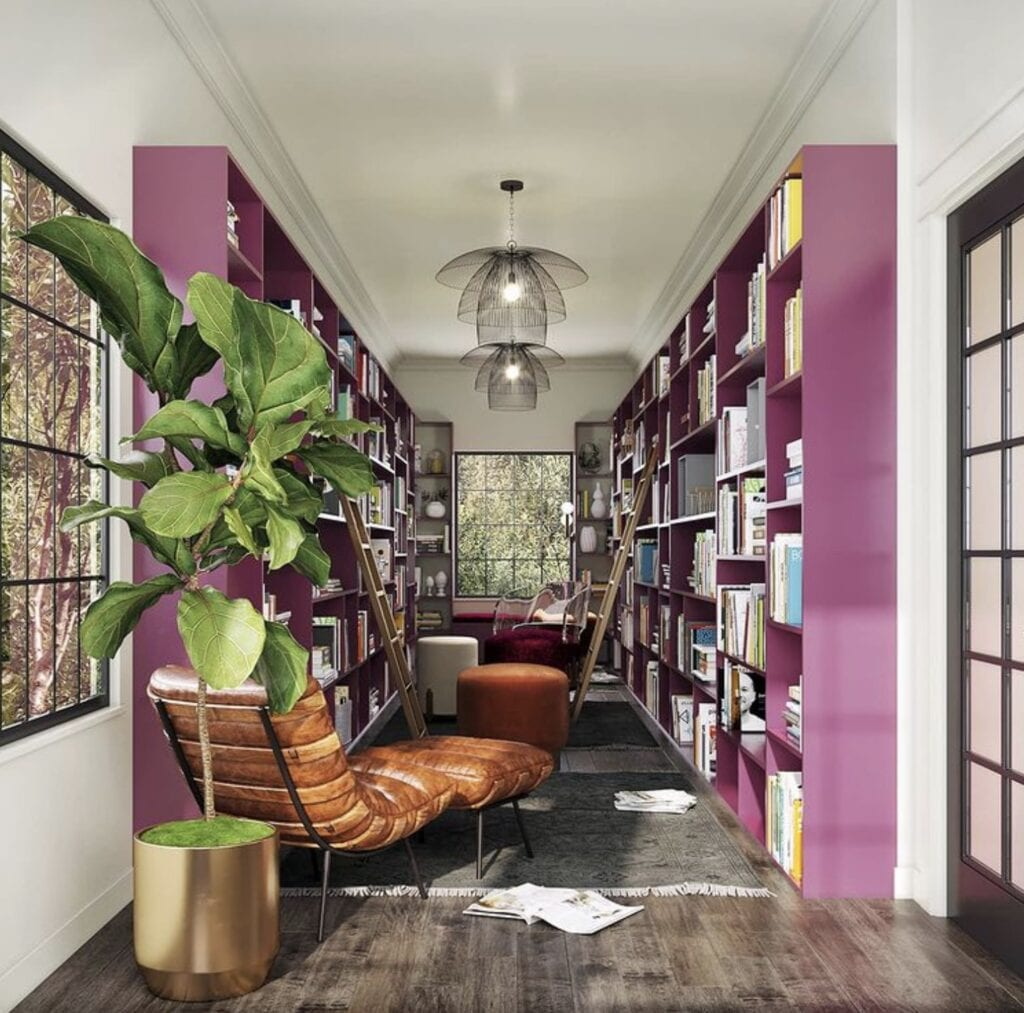 A hallway library with purple shelves designed by Whitney J.