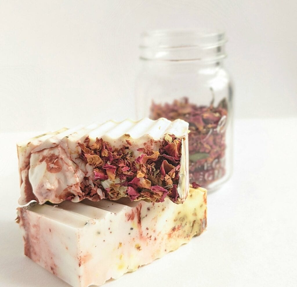 Bar of soap with pink flower petals