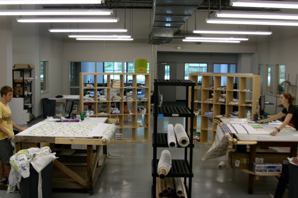 Two fabric cutting tables in one of Spoonflower's first factory spaces