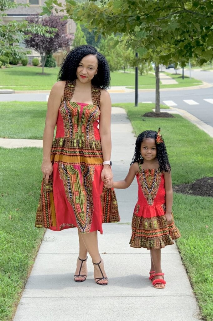 Jaimie with daughter in matching red dresses