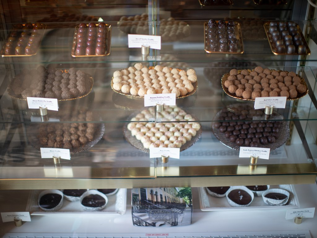 A display case of chocolates from Harlem Chocolate Factory