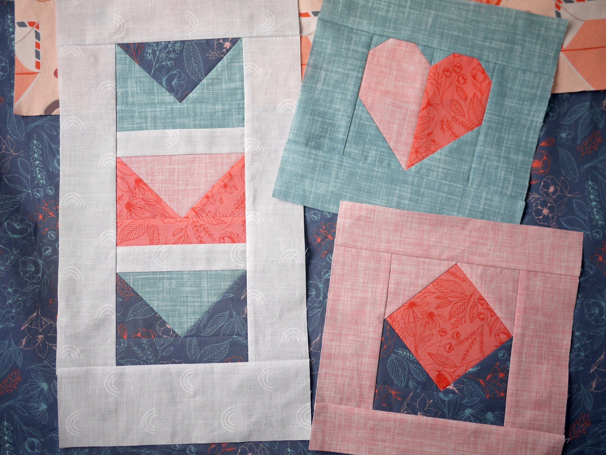 Three quilt blocks separated and laying on the floor