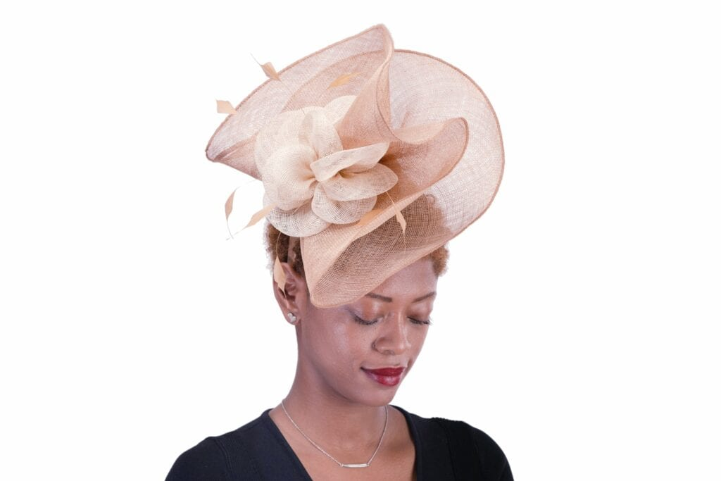 Woman wearing a pink hat from Anthony Maxwell