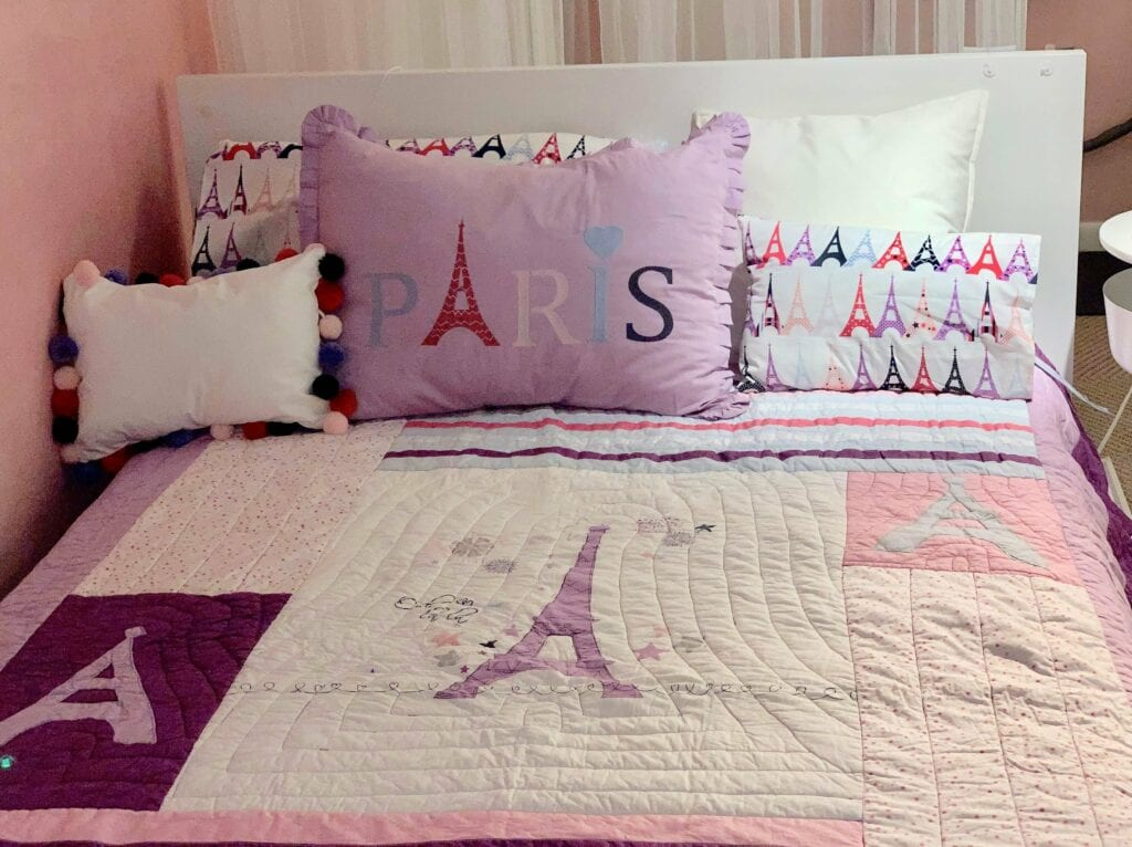 Pink and purple Paris themed bedding from Chez Bebe