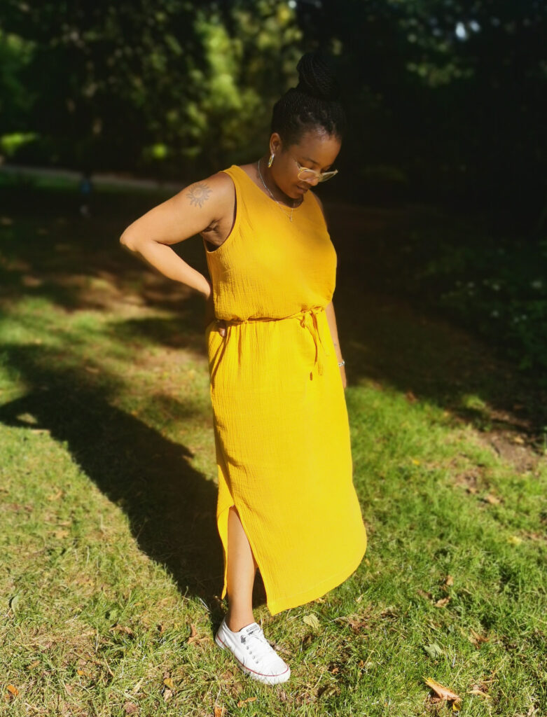 Miranda in a yellow dress