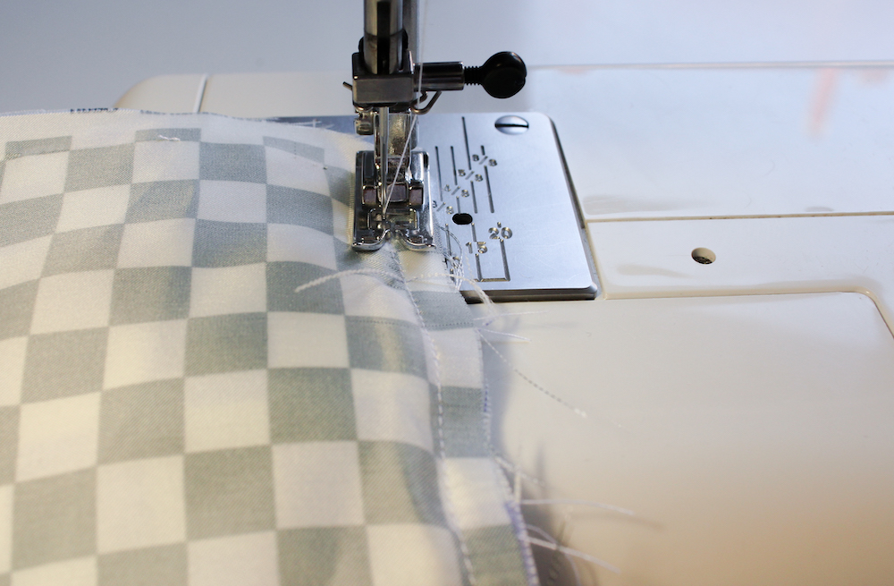 Stitching the lining and outer fabric together with a sewing machine