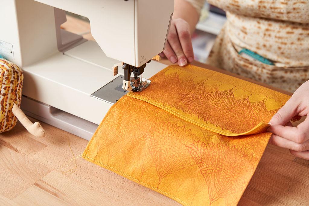 Ace sews the afikomen cover