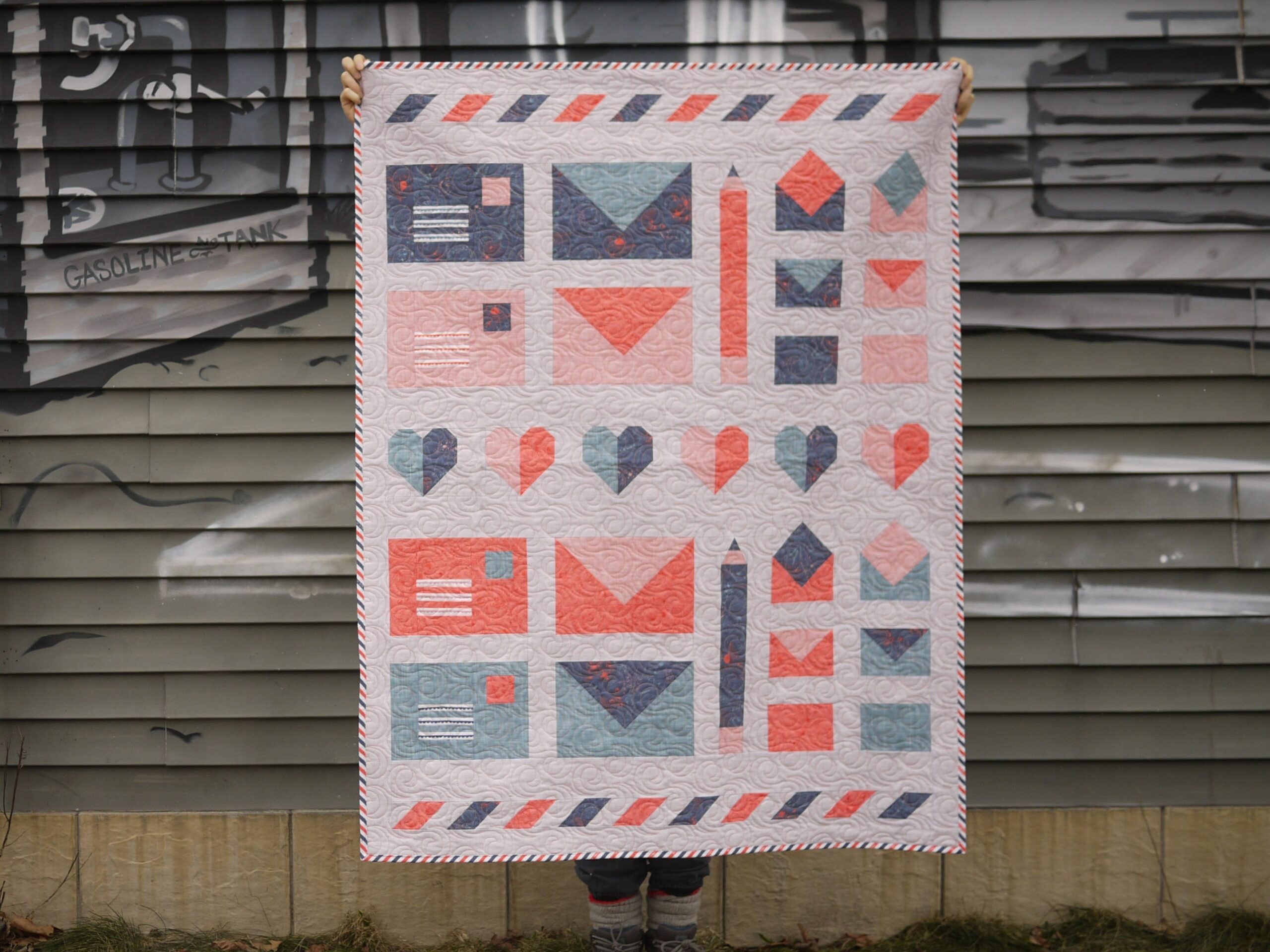 Finished Express Post quilt being held up
