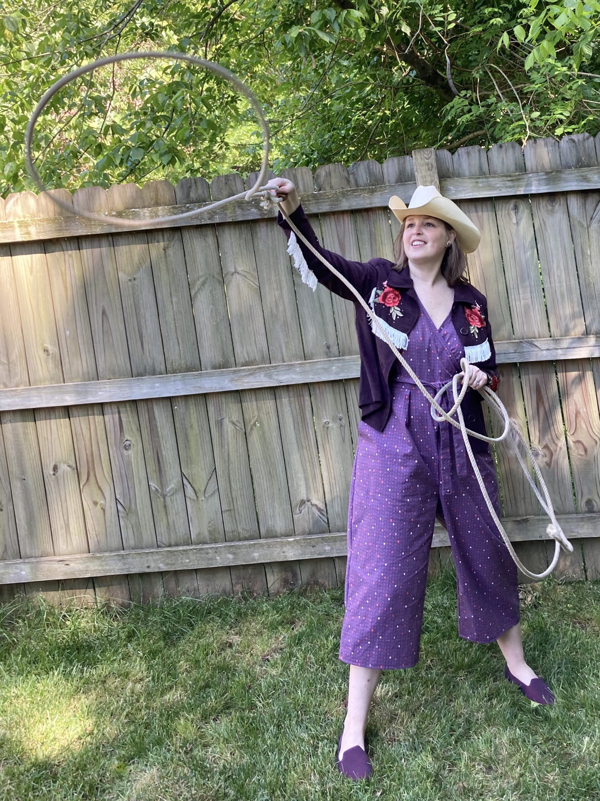 Amy in a handmade jumpsuit with cowboy hat and lasso