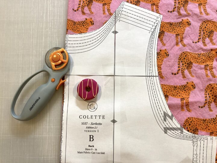 A sewing pattern on top of fabric featuring a cheetah pattern