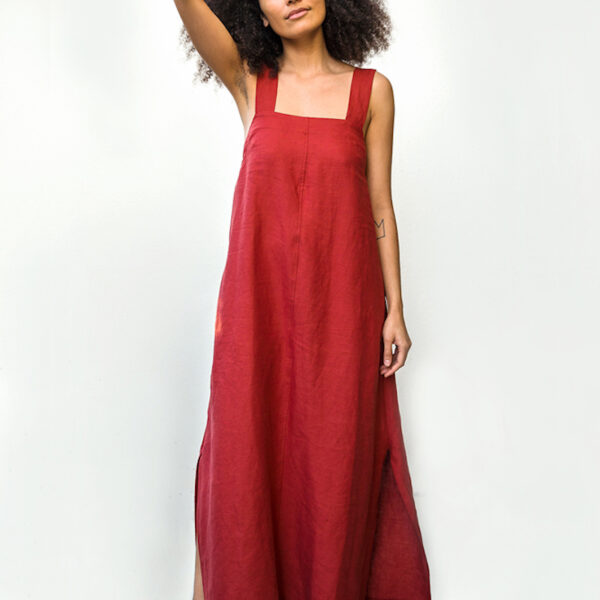 A woman wearing a red maxi dress