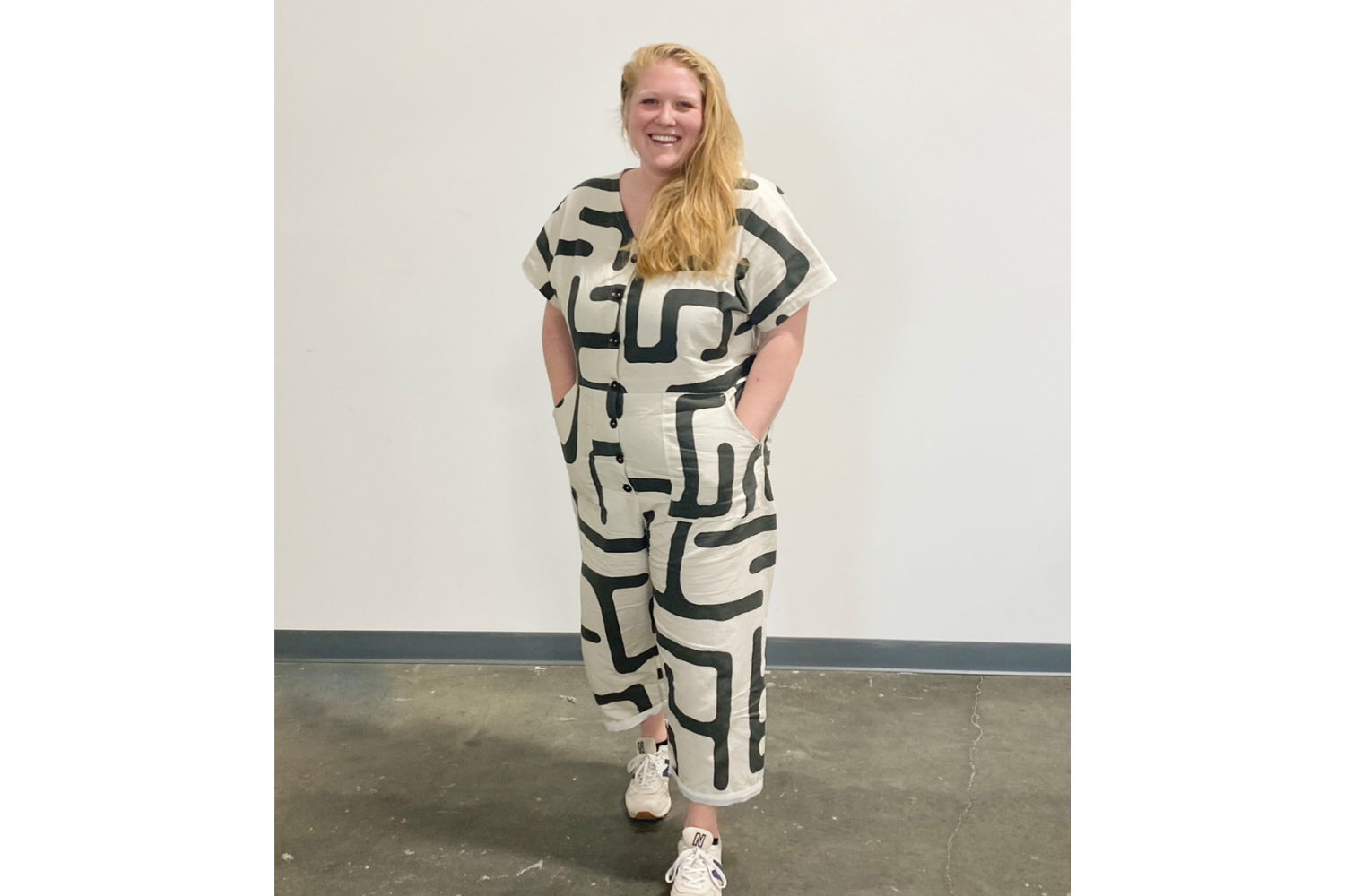 Model wearing jumpsuit with black and white geometric shapes