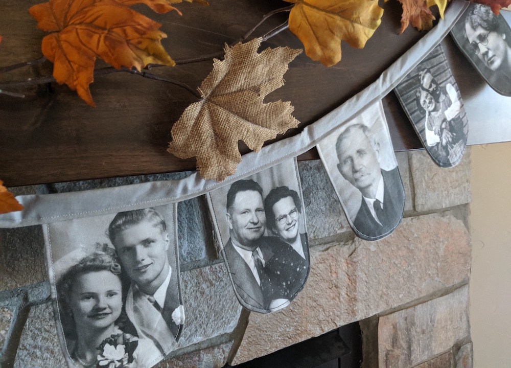 Custom heirloom photo banner hanging on a fireplace mantle