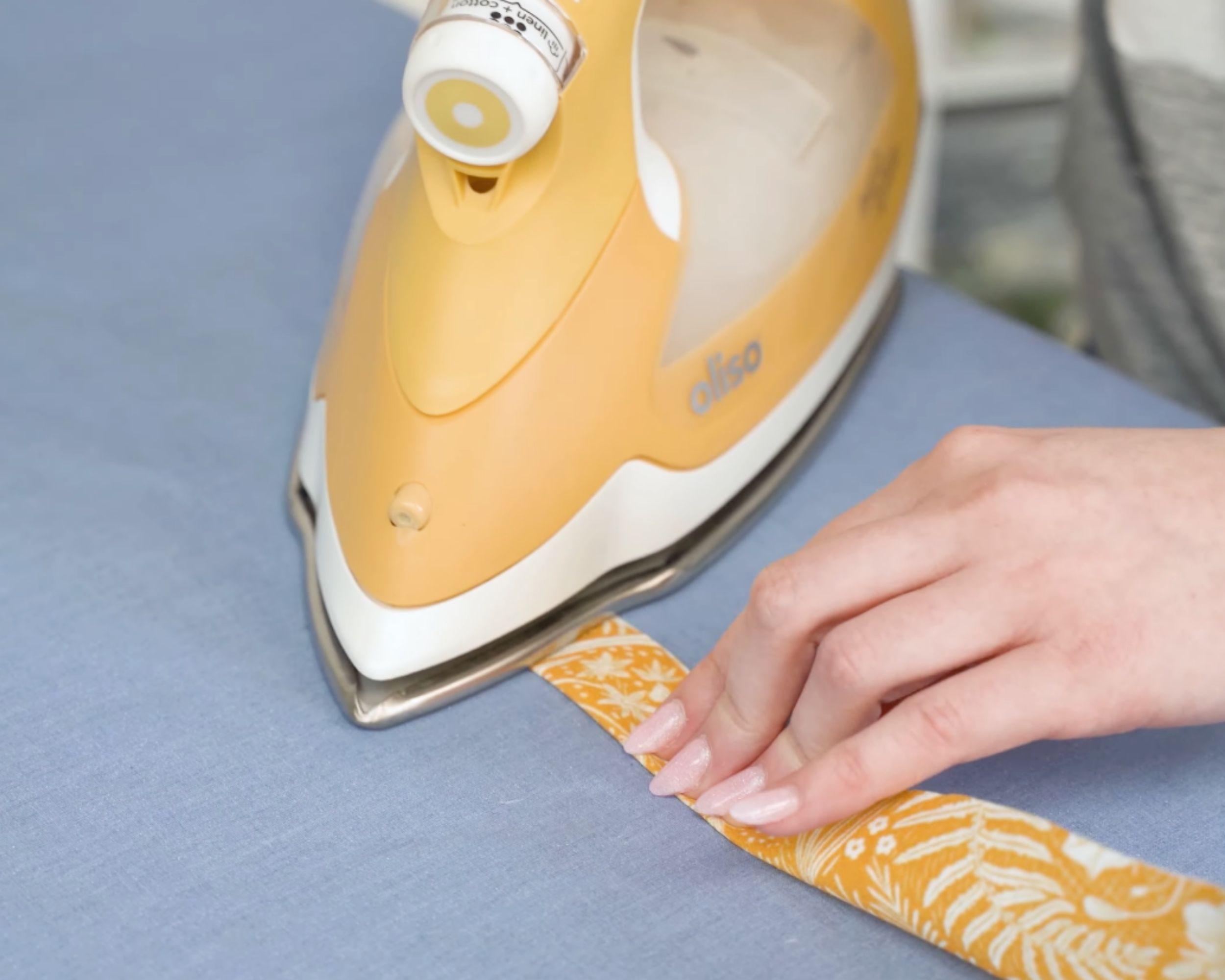 Ironing the placket fabric