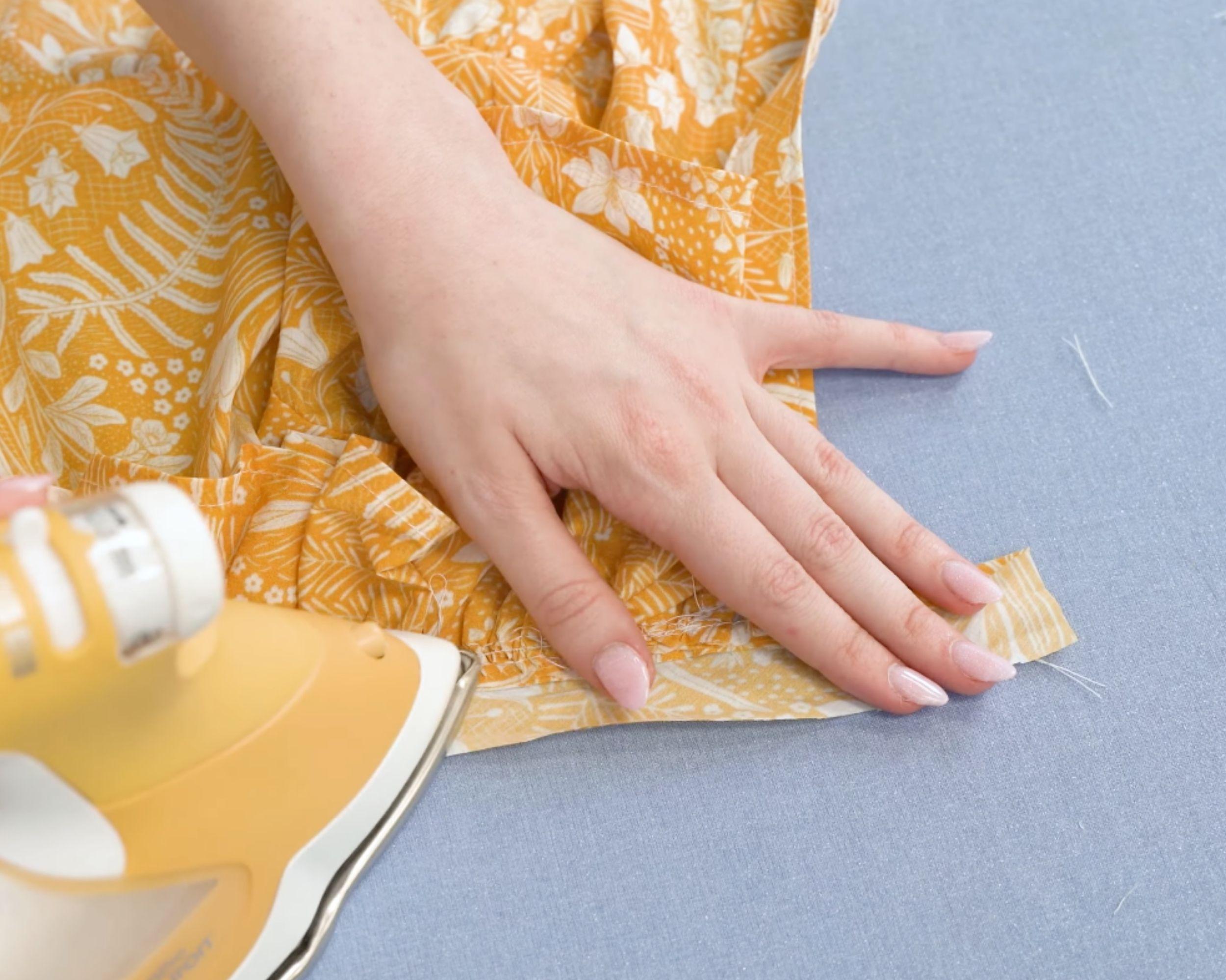 Ironing in the neckline binding