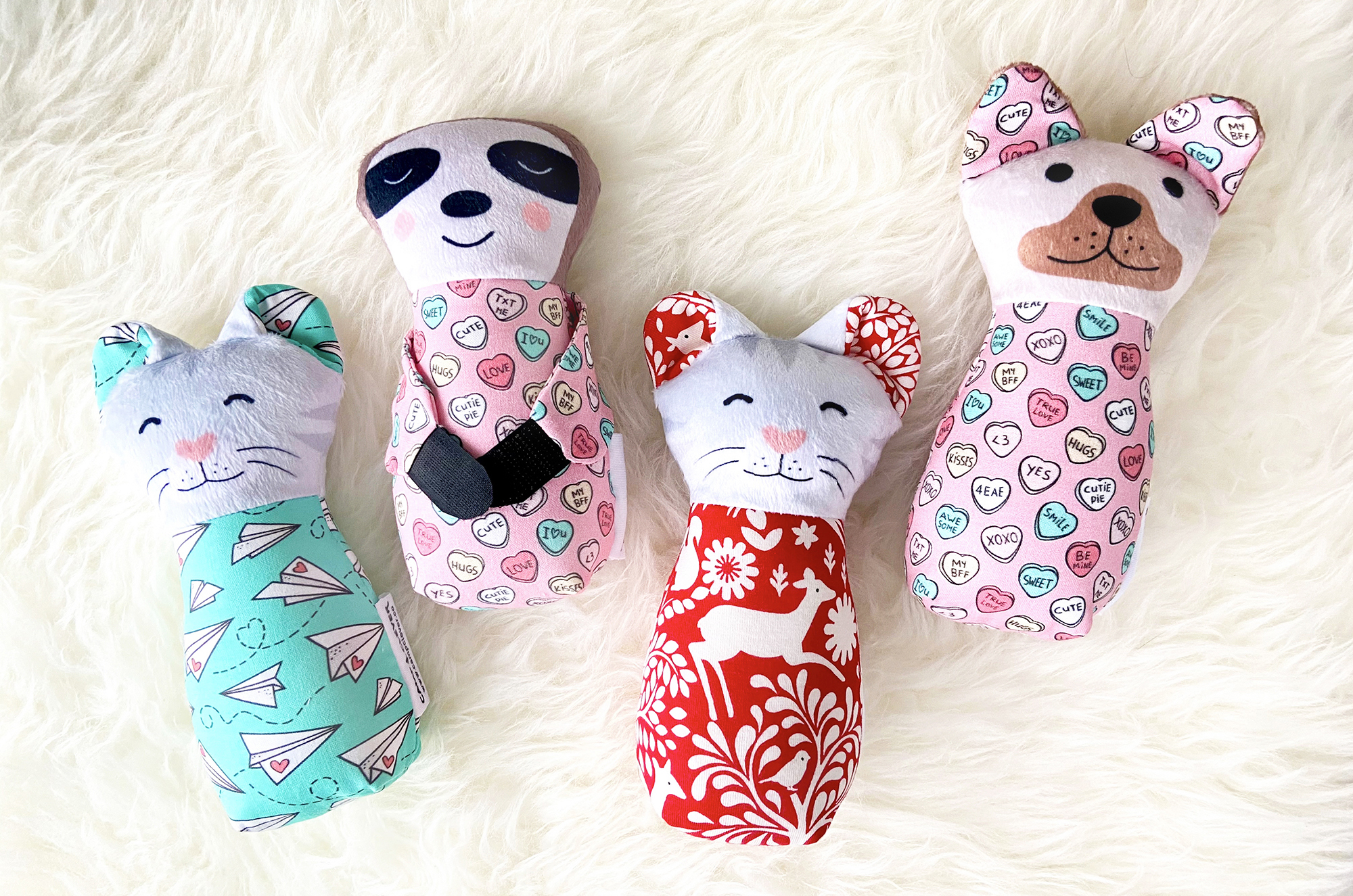 Custom plush animals with Valentine's Day themed surface patterns