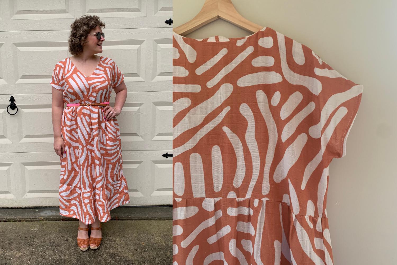 Model wearing orange and white maxi dress