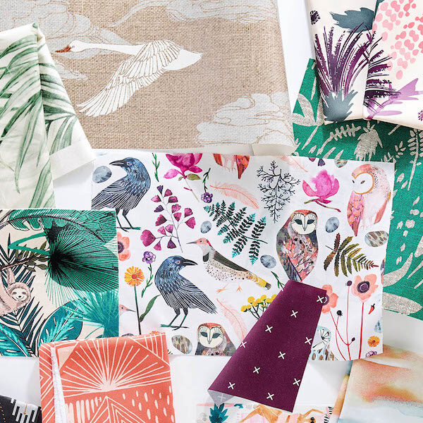 Swatches of fabric and wallpaper with nature inspired designs