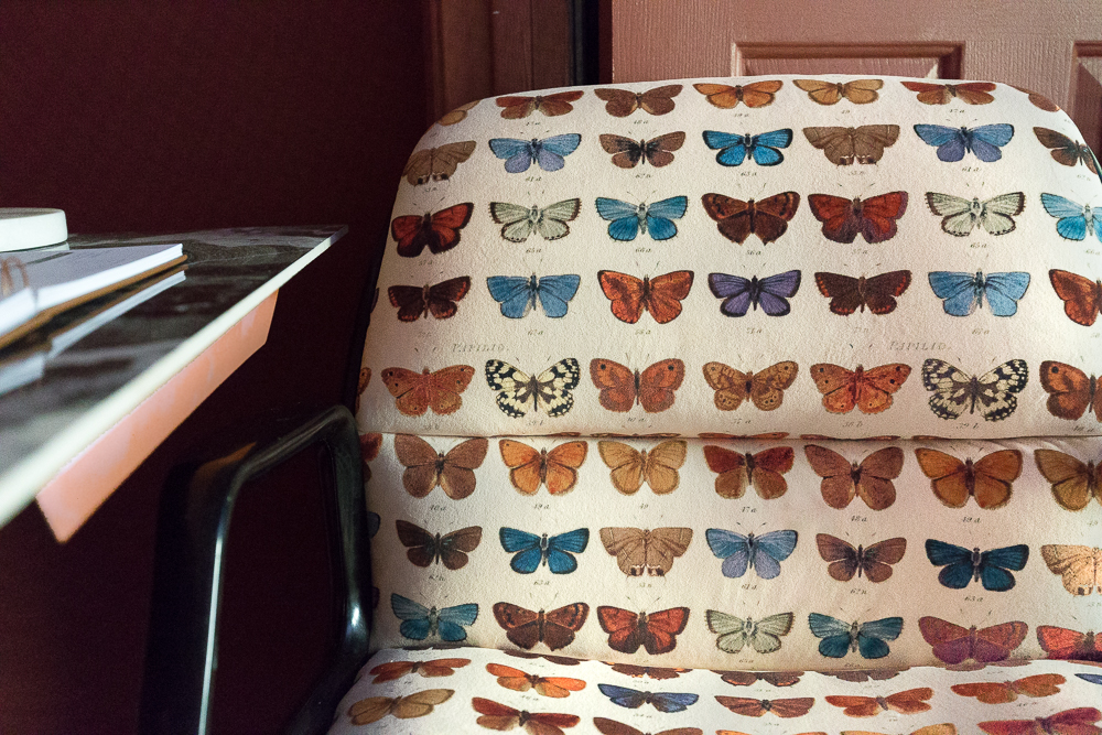 Finished upholstered chair with butterfly fabric