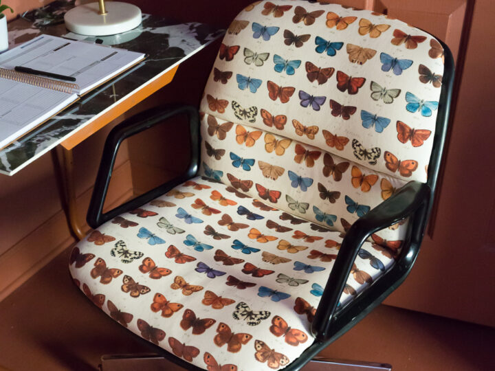 Upholstered chair with butterflies
