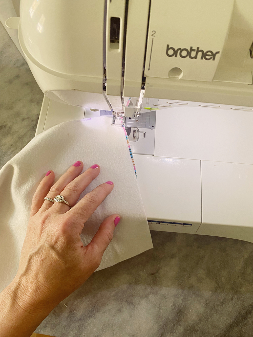 Sewing the fabric strips together with a sewing machine