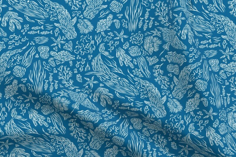 Fabric design with dark blue background and light blue ocean creatures