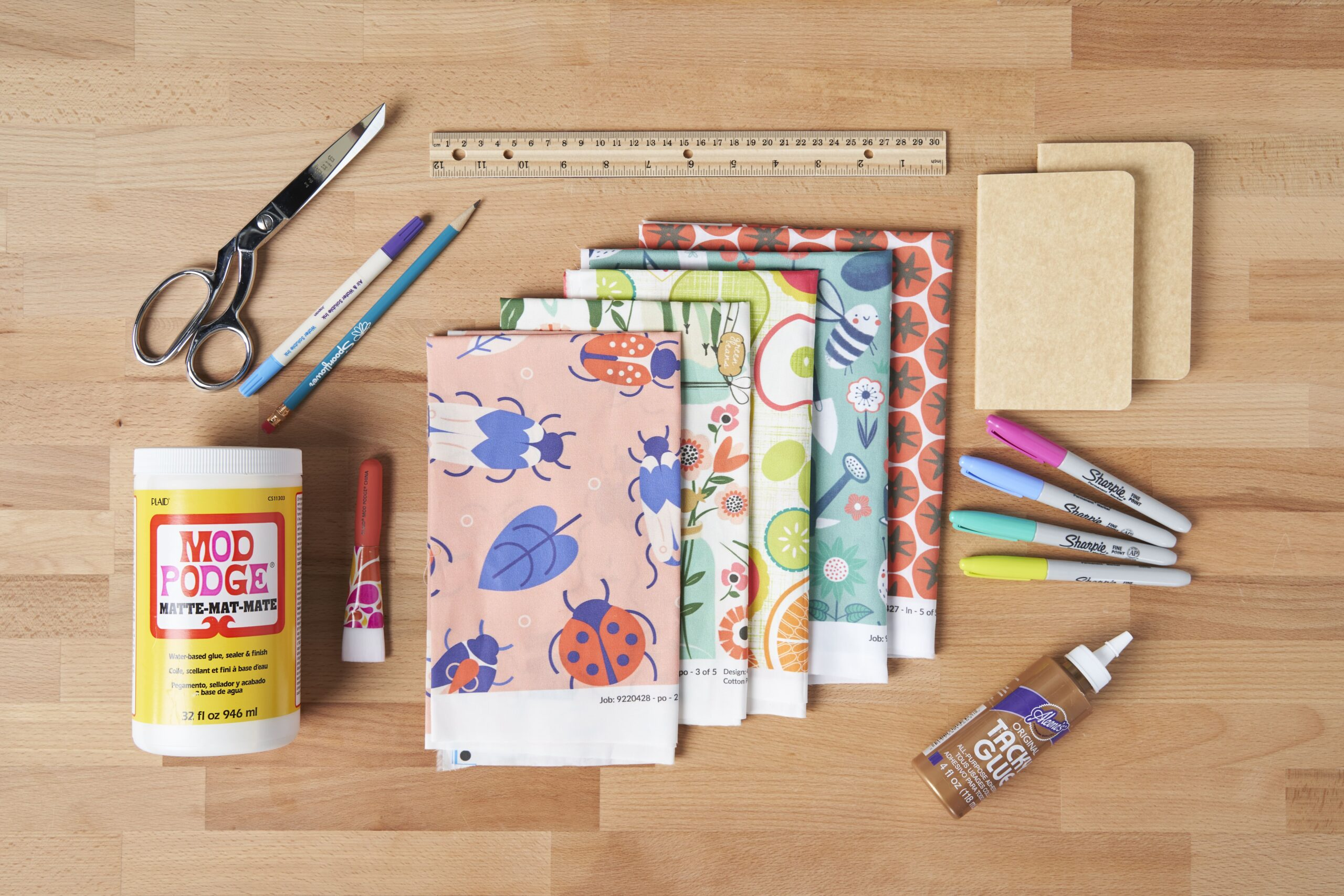 Supplies for the notebook cover spread out on a table