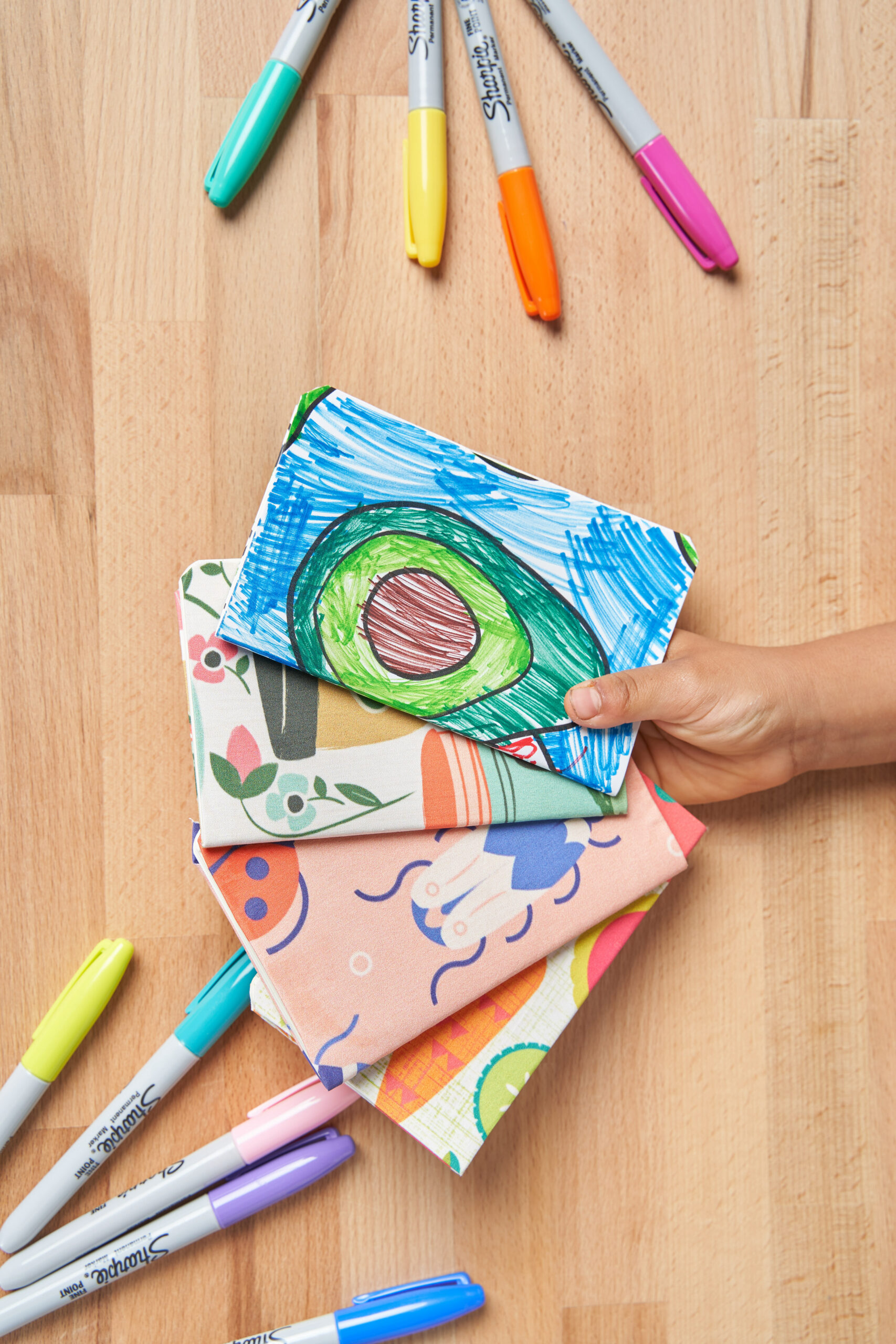 Stack of colorful finished notebook covers