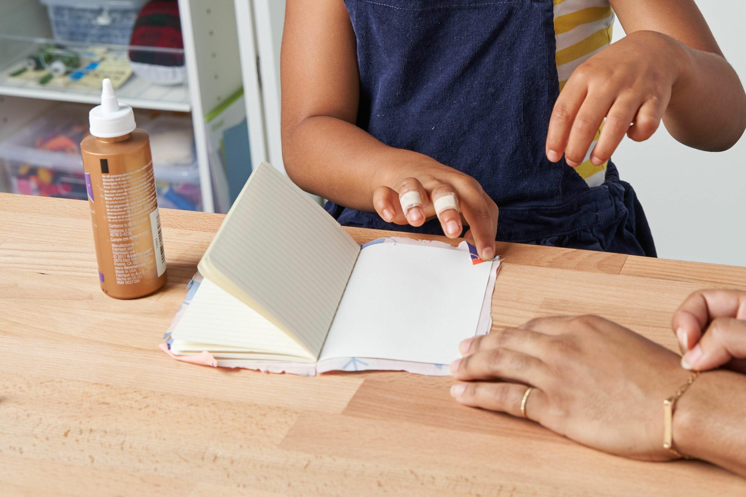 Folding the pre-glued corners down
