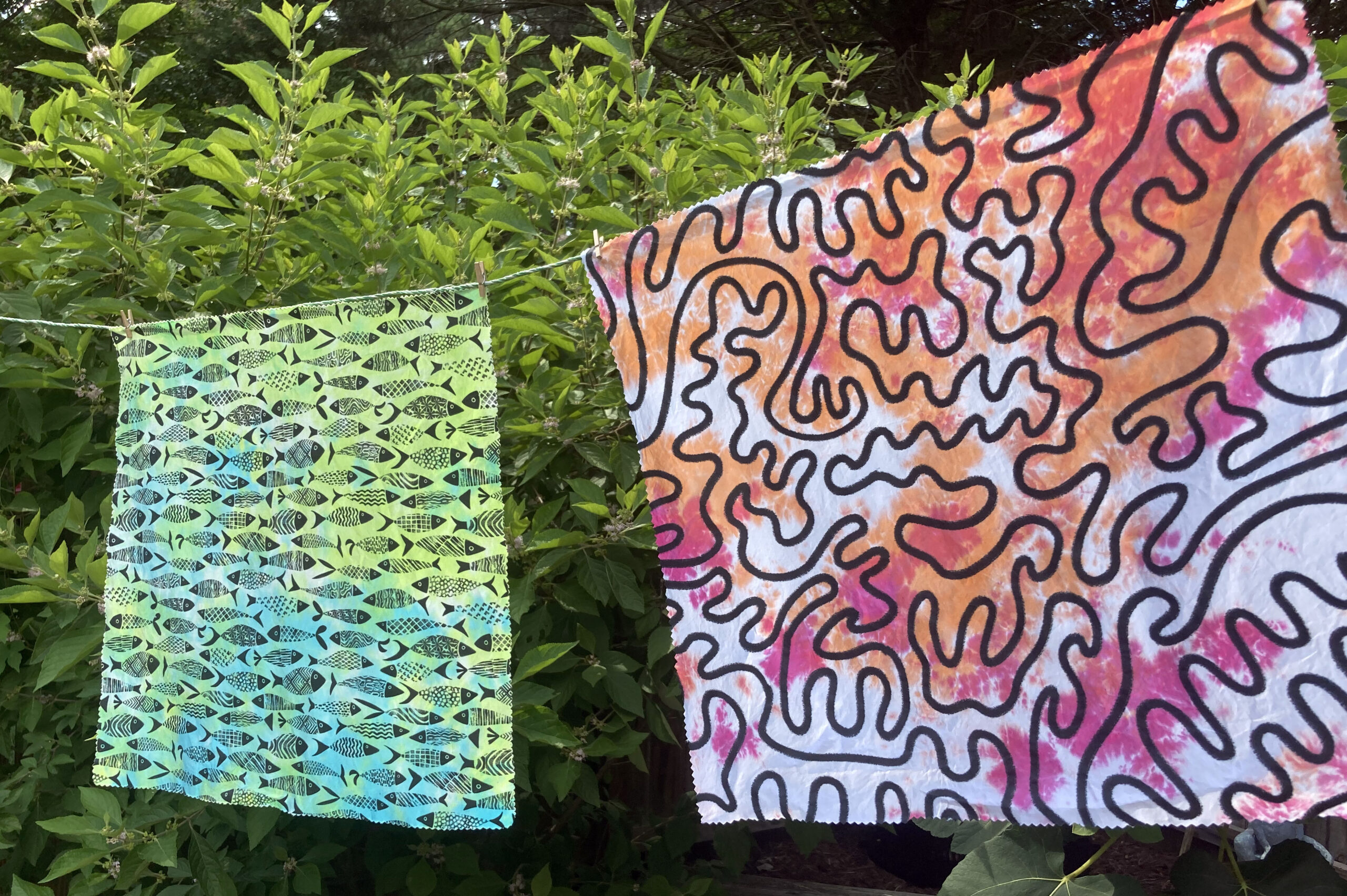 Finished tie dyed fabric hanging on a clothes line