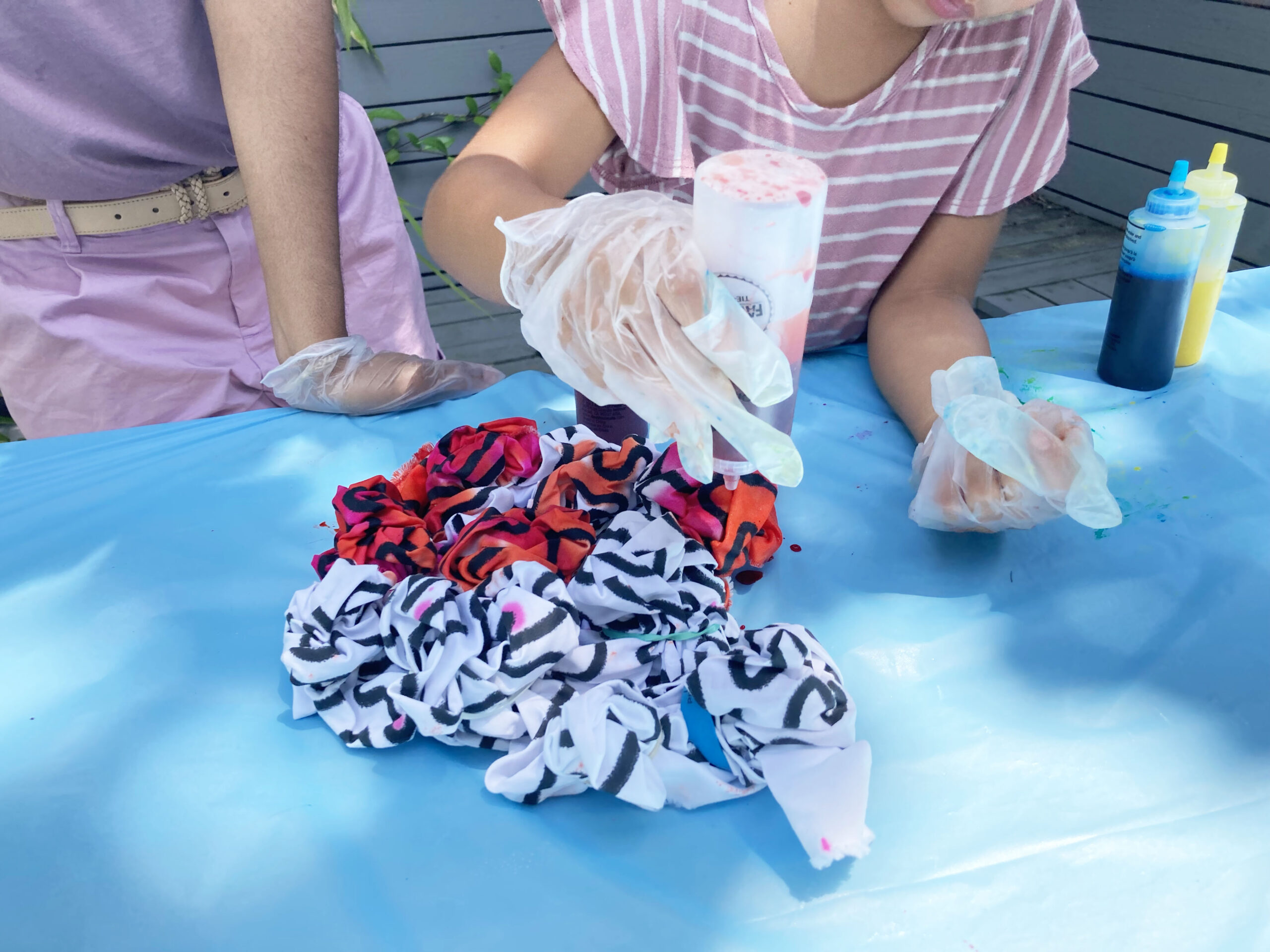 Tie dying the yard of fabric