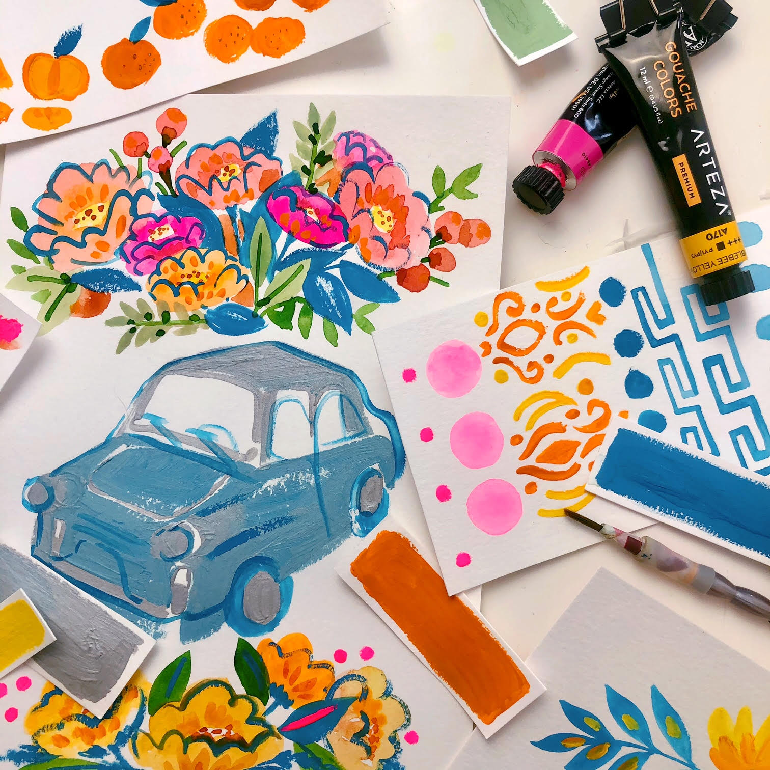Drawings of flowers, cars, and other doodles on paper