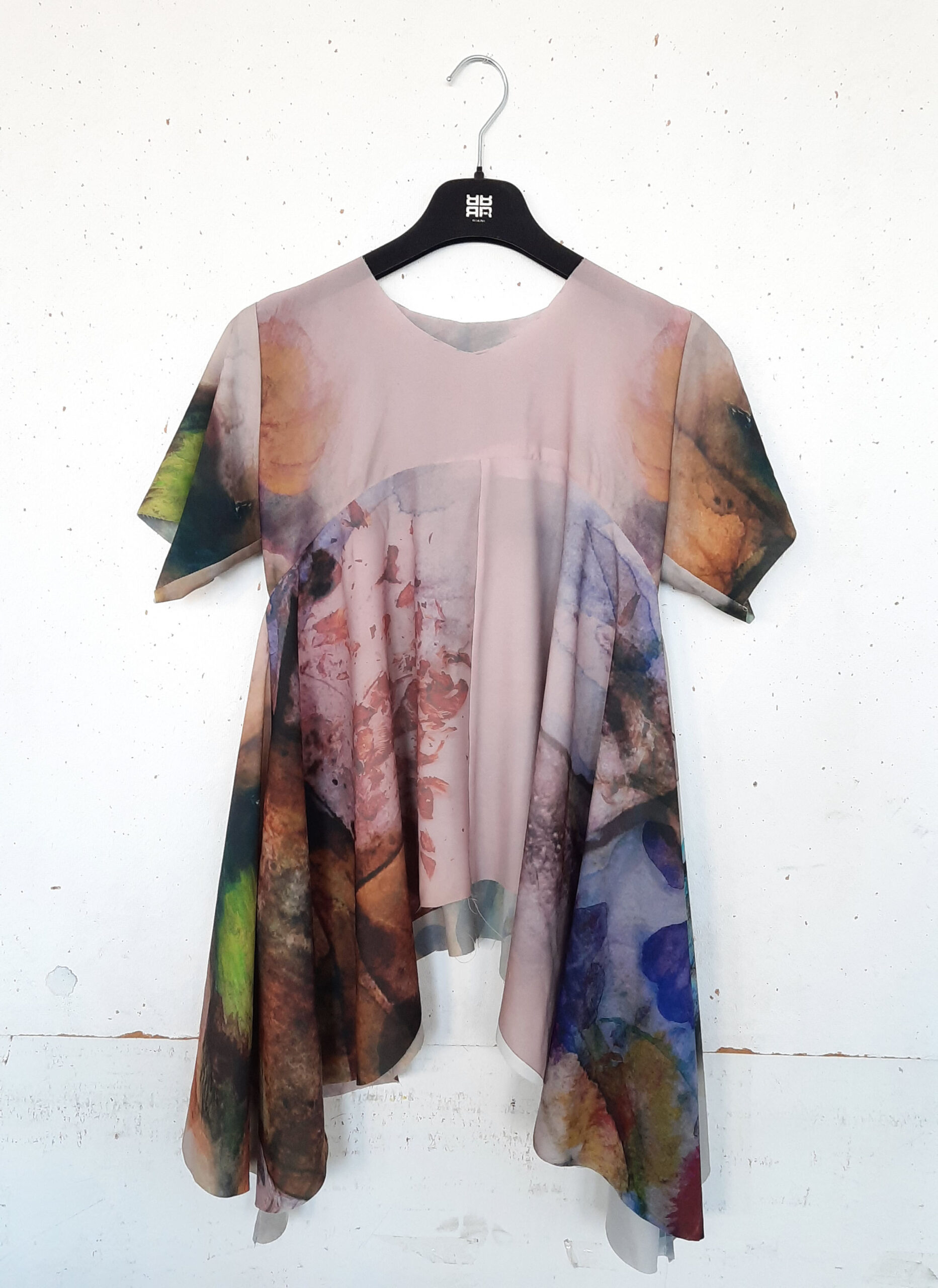 Flowy shirt with multicolor photos printed on it